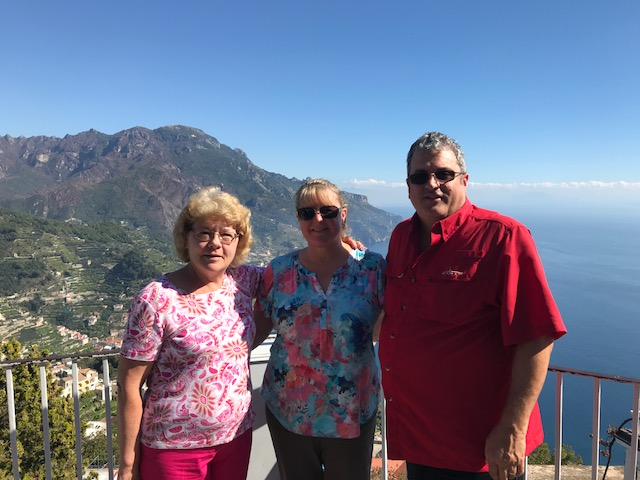 three people with mountain in background